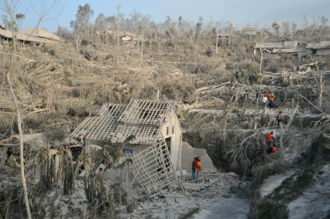 Indonesian search and rescue teams explore the area after Mount Merapi volcano erupted the night before in the village of Pakem in Sleman, Yogyakarta province on October 27, 2010. (CLARA PRIMA/AFP/Getty Images) #