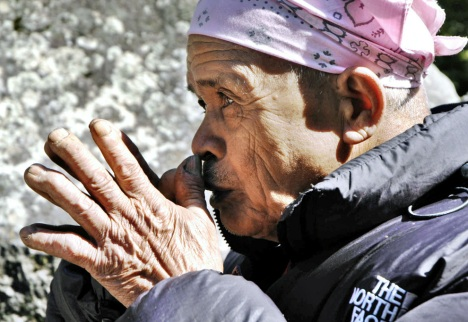 This file photo taken on May 17, 2006 shows Mbah Marijan, the appointed guardian for Mount Merapi by Yogyakarta's highly respected Sultan Hamengkubuwono X as he prays for the people's safety in Kinahrejo. Marijan was one of the victims of the eruption. Grandfather Marijan was found dead - reportedly discovered in a prayer position - inside his burnt house about four kilometers (2.5 miles) from the peak, local officials said.(Tarko SUDIARNO/AFP/Getty Images) #