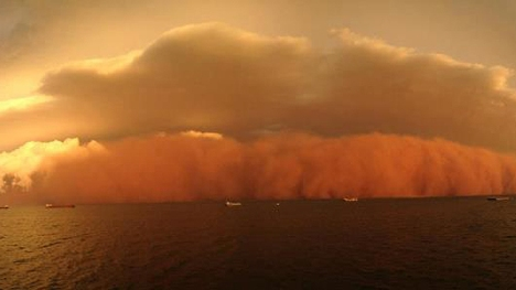 Dust storm: freakish storm bears down on shipping in the Indian Ocean near Onslow, WA. Picture: Levi Cooper/PerthWeatherLive.com